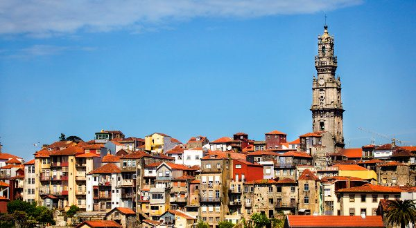 Clerigos church tower and Ribeira old town skyline (Porto, Portugal)