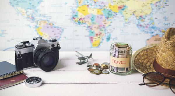 Collecting money for travel with accessories of traveler, Travel concept