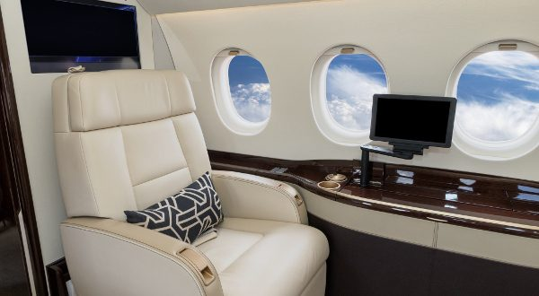 Comfortible cabin chair in a modern business jet during flight.