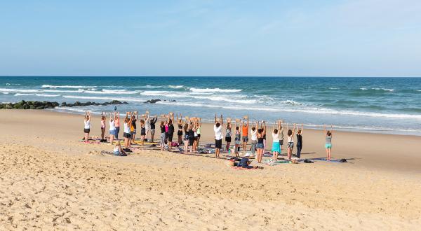 Lacanau, France. Yoga sur la plage iStock